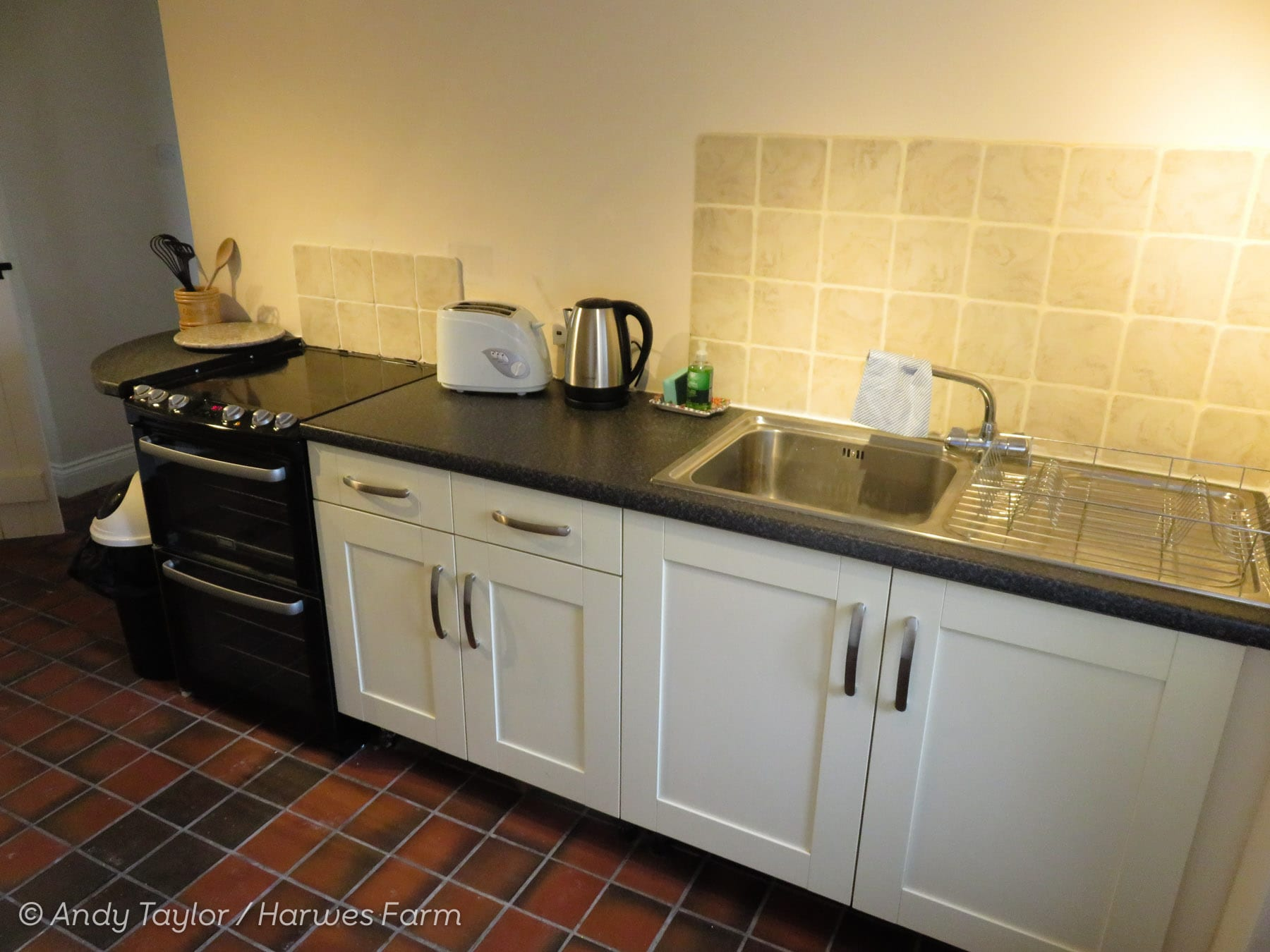 Kitchen sink area and cooker